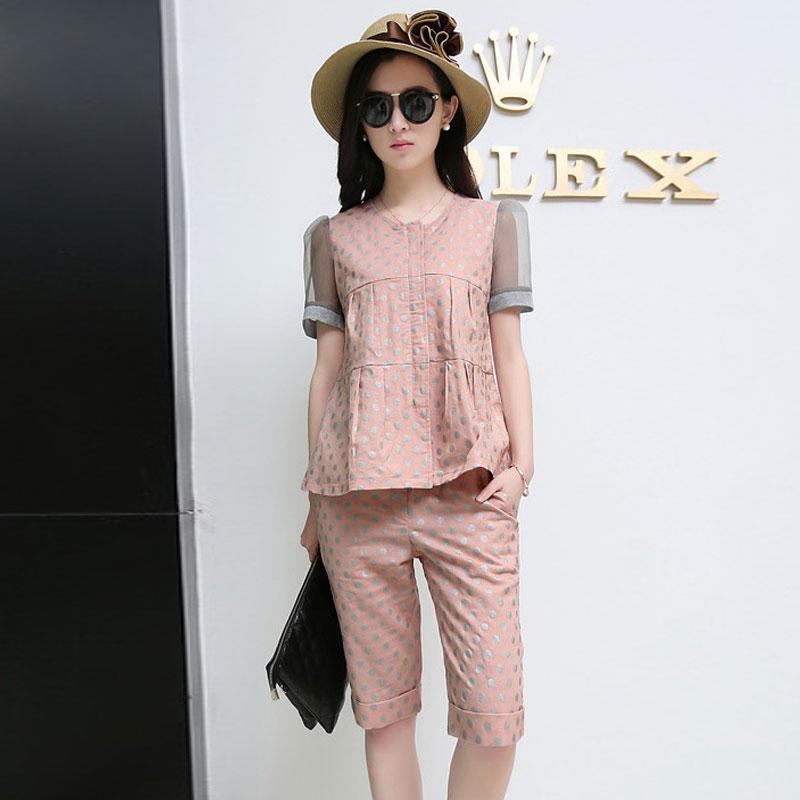 ชุดเซ็ทเสื้อกางเกงสีชมพู เสื้อแขนสั้น ช่วงแขนเย็บผ้าตาข่าย พิมพ์ลายชุด