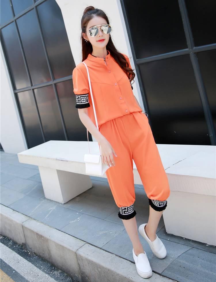 ชุด 2 ชิ้น เสื้อแฟชั่น คอปีน แขนจั๊ม + กางเกง3 ส่วน สีส้ม
