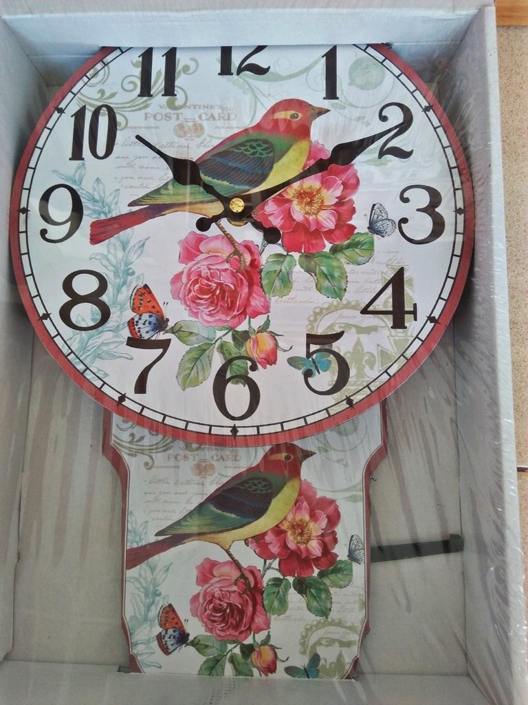 นาฬิกาสังกะสีแบบมีลูกตุ้มแกว่งไปมา