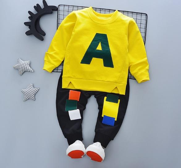 ชุดเซ็ตเด็กผ้ายืดเสื้อเหลือง A กางเกงสีดำ